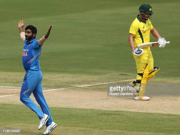 Jasprit Bumrah of India celebrates taking the wicket of Aaron Finch of Australia during game one of the One Day International series between India...