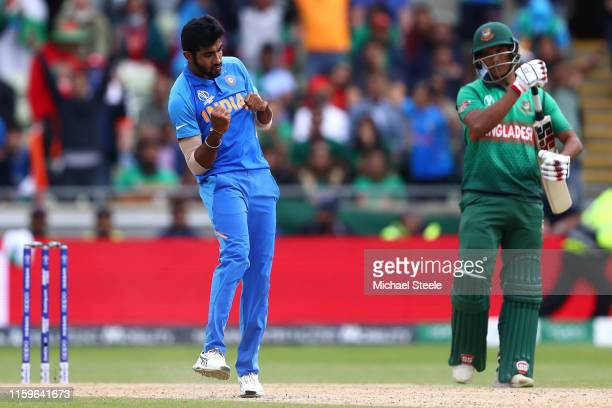 Jasprit Bumrah of India celebrates taking the wicket of Mustafizur Rahman and wrapping up his side's 28 run win during the Group Stage match of the...