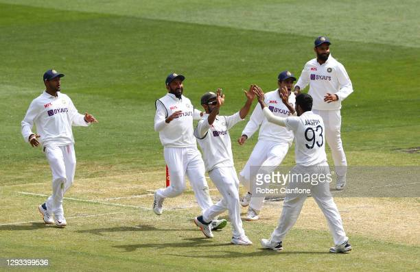 Jasprit Bumrah of India celebrates taking the wicket of Steve Smith of Australia during day three of the Second Test match between Australia and...