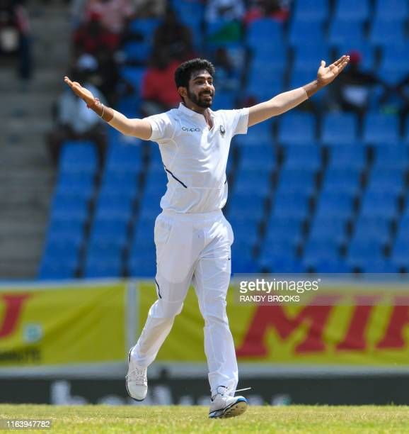 Jasprit Bumrah of India celebrates the dismissal of Kraigg Brathwaite of West Indies during day 4 of the 1st Test between West Indies and India at...