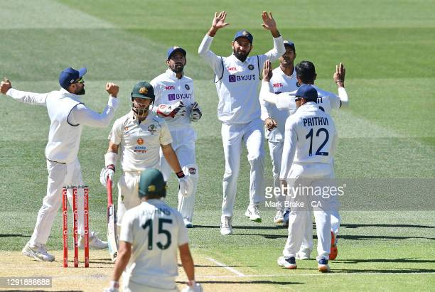 Jasprit Bumrah of India celebrates the wicket of Matthew Wade of Australia lbw with his team mates during day two of the First Test match between...