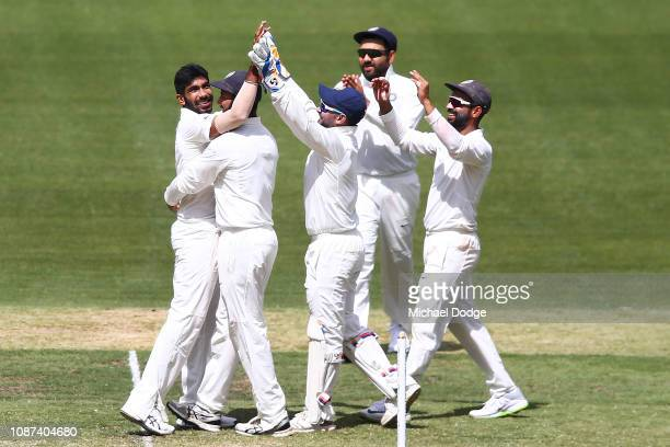 Jasprit Bumrah of India celebrates the wicket of Nathan Lyon of Australia during day three of the Third Test match in the series between Australia...