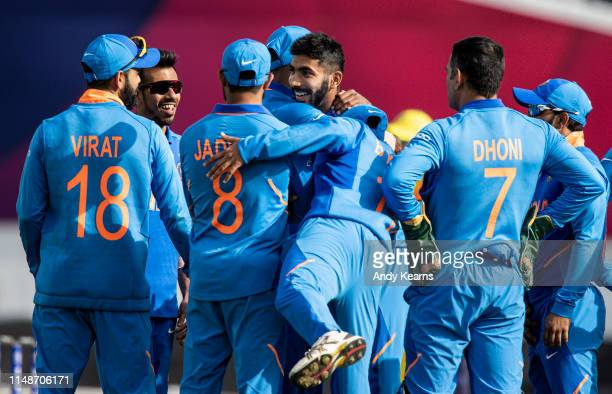 Jasprit Bumrah of India celebrates with his team mates after taking the wicket of Usman Khawaja of Australia during the Group Stage match of the ICC...