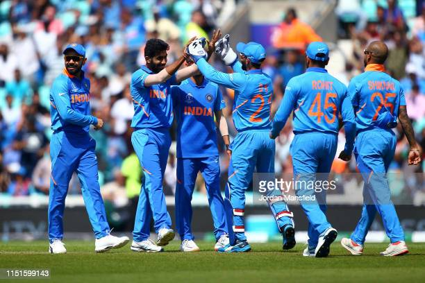Jasprit Bumrah of India celebrates with his teammates after dismissing Colin Munro of New Zealand during the ICC Cricket World Cup 2019 Warm Up match...