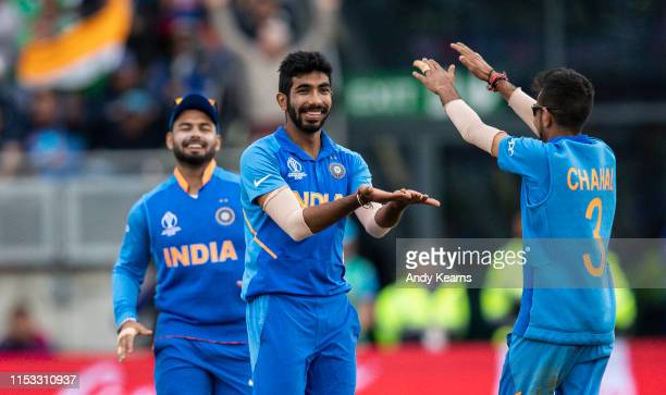 Jasprit Bumrah of India celebrates with team mate Yuzvendra Chahal after taking the wicket of Sabbir Rahman of Bangladesh during the Group Stage...