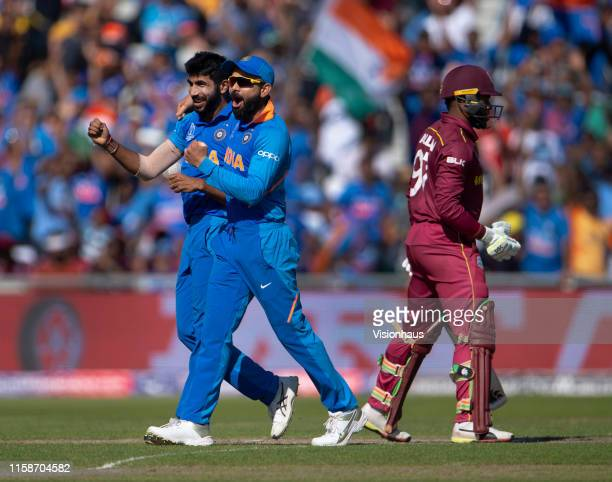 Jasprit Bumrah of India celebrates with Virat Kohli after taking the wicket of Fabian Allen of West Indies during the Group Stage match of the ICC...