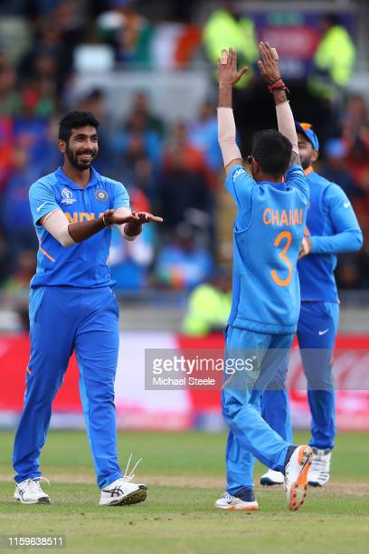 Jasprit Bumrah of India celebrates with Yuzvendra Chahal after bowling Sabbir Rahman of Bangladesh during the Group Stage match of the ICC Cricket...