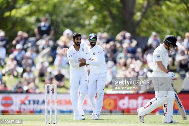 Jasprit Bumrah of India is congratulated by team mates after dismissing BJ Watling of New Zealand during day two of the Second Test match between New...