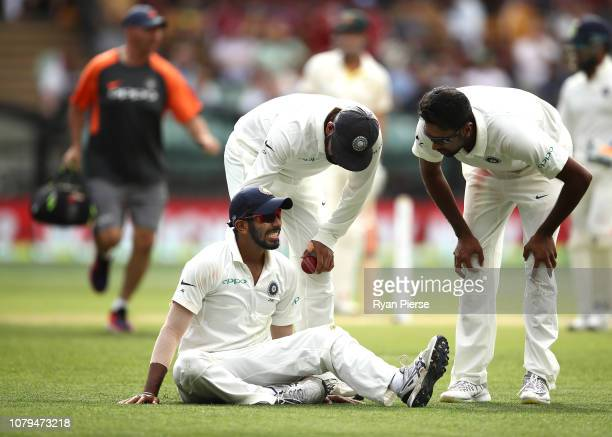 Jasprit Bumrah of India of India reacts after injuring his shoulder while fielding during day four of the First Test match in the series between...
