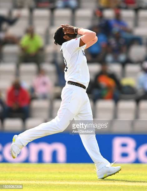 Jasprit Bumrah of India reacts after a drop during the Reserve Day of the ICC World Test Championship Final between India and New Zealand at The...