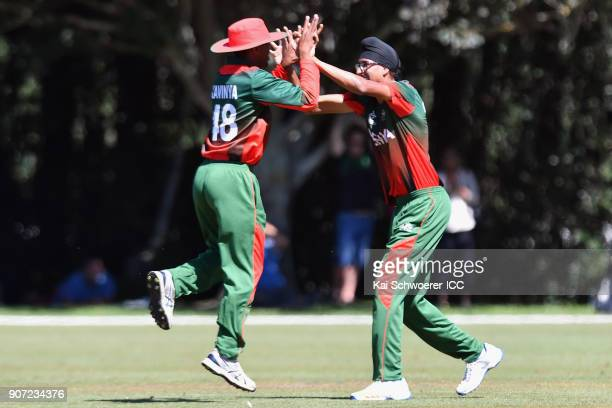 Jasraj Kundi of Kenya is congratulated by Ankit Hirani of Kenya after dismissing Keagan Simmons of the West Indies during the ICC U19 Cricket World...