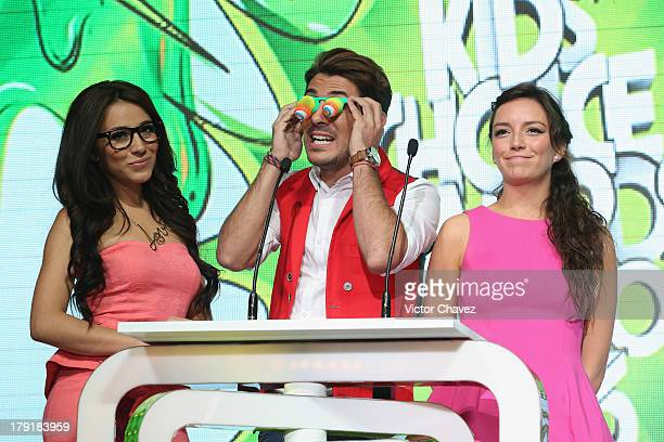 Jass Reyes and Diego Alfonzo speak onstage during the Kids Choice Awards Mexico 2013 at Pepsi Center WTC on August 31 2013 in Mexico City Mexico