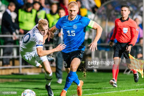 Jasse Tuominen and Ragnar Klavan with the ball during the UEFA Nations League football match between Finland and Estonia at the Veritas Stadium in...