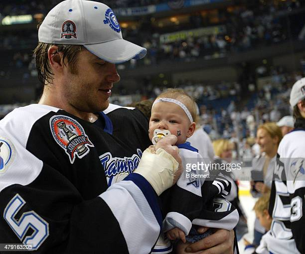 Jassen Cullimore of the Tampa Bay Lightning holds his daughter after defeating the Calgary Flames in Game 7 of the NHL Stanley Cup Finals on June 7...