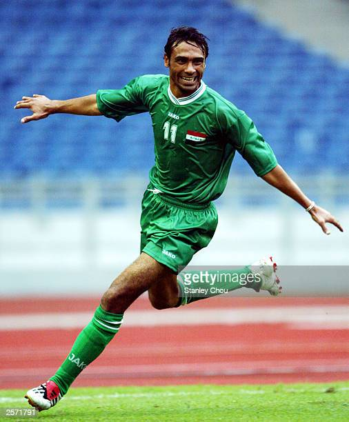 Jassim S. Fayadh of Iraq celebrates after scoring the first goal during the match between Iraq and Bahrain during the Group F Asian Cup qualifier...