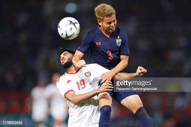Jassim Yaqoob Salman of United Arab Emirates and Theerathon Bunmathan of Thailand during the FIFA World Cup Asian Qualifier second round match...