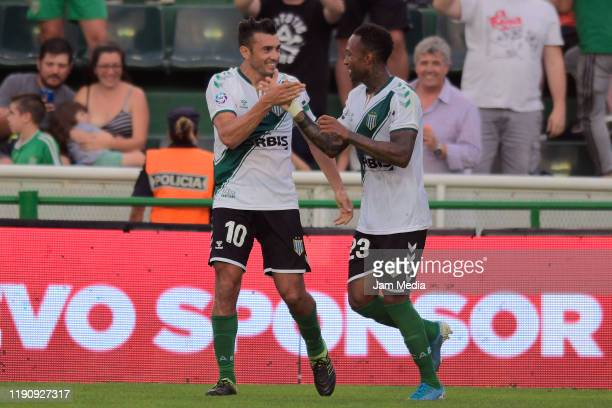 Jasus Datolo and Junior Arias of Banfield celebrate the first goal of their team during a match between Banfield and Gimnasia y Esgrima La Plata as...