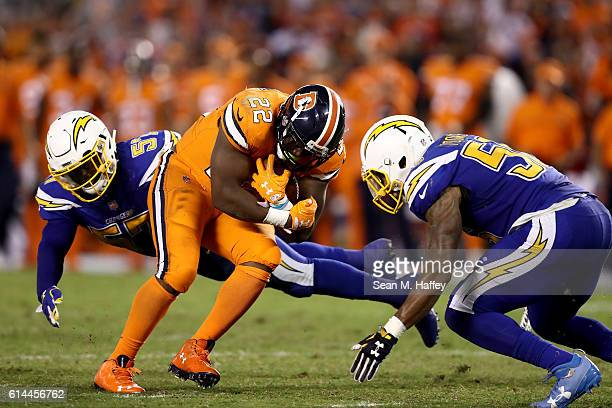 Jatavis Brown and Korey Toomer of the San Diego Chargers tackle CJ Anderson of the Denver Broncos during the second half of a game at Qualcomm...