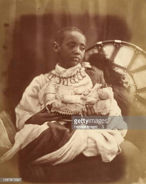 D�jatch Al�mayou King Theodore's Son July 1868 The young orphaned prince cradles a little white doll and stares sadly into space D�jatch Al�mayou was...