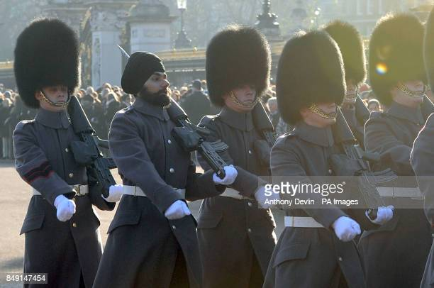 Jatinderpal Singh Bhullar becomes the first person to guard the Queen wearing a turban instead of a traditional bearskin as F Company Scots Guard...