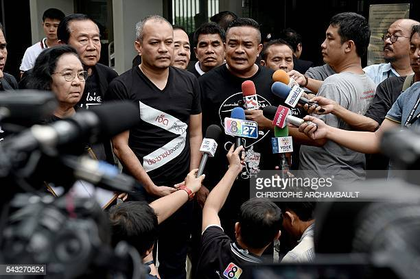 Jatuporn Prompan the leader of Thailand's prodemocracy 'Red Shirt' street movement answers reporters' questions outside the British Embassy in...