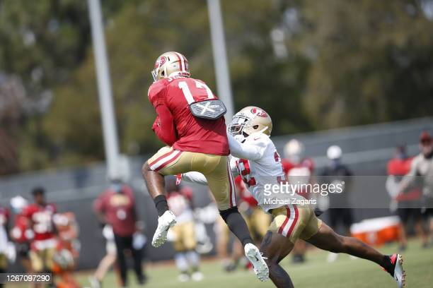 Jauan Jennings of the San Francisco 49ers makes a reception as Jamar Taylor defends during training camp at the SAP Performance Facility on August...