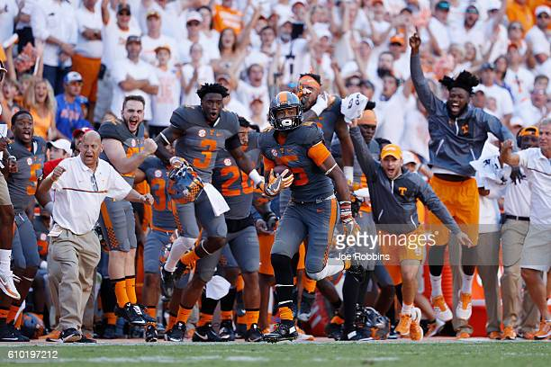 Jauan Jennings of the Tennessee Volunteers runs up the sideline with a 67yard touchdown reception against the Florida Gators in the fourth quarter at...