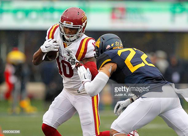 Jauan Wesley of the Iowa State Cyclones is ran out of bounds by Jarrod Harper of the West Virginia Mountaineers in the first half during the game on...