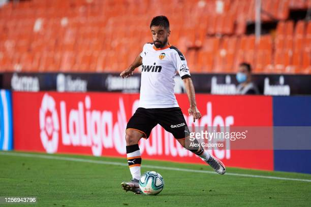 Jaume Costa of Valencia CF plays the ball during the Liga match between Valencia CF and RCD Espanyol at Estadio Mestalla on July 16 2020 in Valencia...