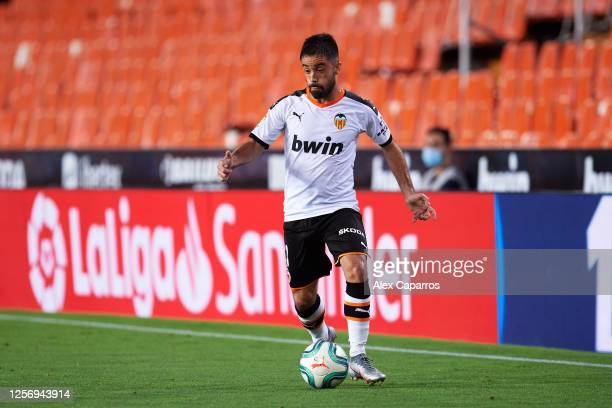Jaume Costa of Valencia CF runs with the ball during the Liga match between Valencia CF and RCD Espanyol at Estadio Mestalla on July 16 2020 in...