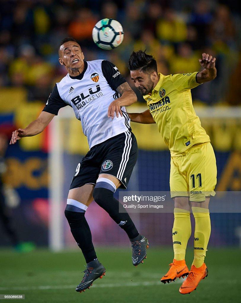 Jaume Costa (R) of Villarreal competes for the ball with Rodrigo Moreno Valencia during the La Liga match between Villarreal and Valencia at Estadio de la Ceramica on May 5, 2018 in Villarreal, Spain.