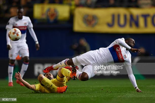 Jaume Costa of Villarreal competes for the ball with Tanguy Ndombele of Olympique Lyon during UEFA Europa League Round of 32 match between Villarreal...