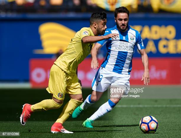 Jaume Costa of Villarreal competes for the ball with Unai Lopez of Leganes during the La Liga match between Villarreal CF and CD Leganes at Estadio...