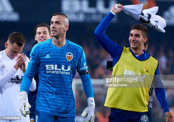 Jaume Domenech and Ferran Torres of Valencia CF celebrate the pass to the final with their fans during the Copa del Rey match between Valencia CF and...