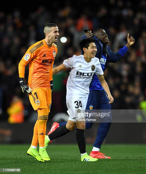 Jaume Domenech of Valencia celebrates with Lee KangIn of Valencia after the final whistle during the Copa del Rey Quarter Final match between...