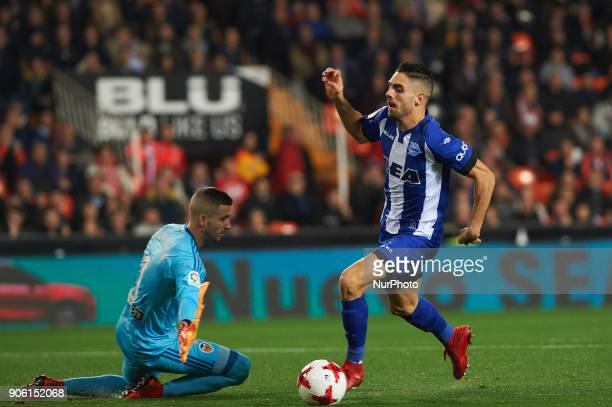 Jaume Domenech of Valencia CF and Ruben Sobrino of Deportivo Alaves during the Spanish Copa del Rey Round of 8 match between Valencia CF and...