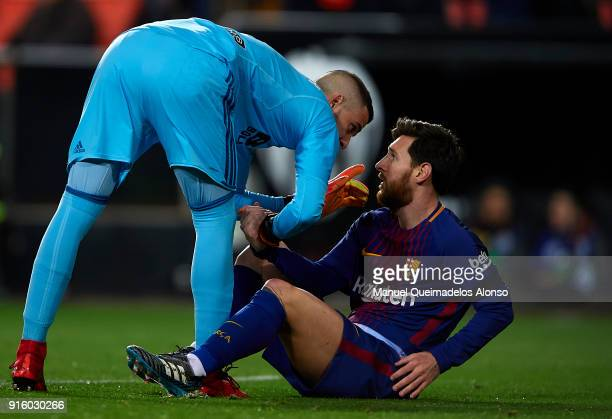 Jaume Domenech of Valencia reacts to Lionel Messi of Barcelona during the Copa del Rey semifinal second leg match between Valencia and Barcelona on...