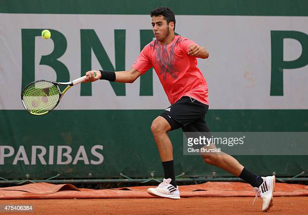 Jaume Munar of Spain plays a forehand in his boy's singles match against Andrea Pellegrino of Italy on day eight of the 2015 French Open at Roland...