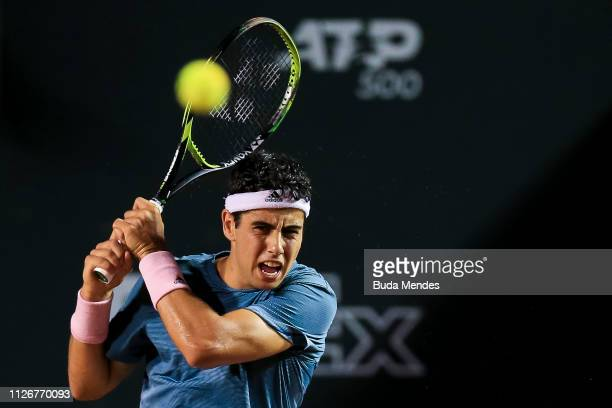 Jaume Munar of Spain returns a shot to Felix AugerAliassime of Canada during the ATP Rio Open 2019 at Jockey Club Brasileiro on February 22 2019 in...