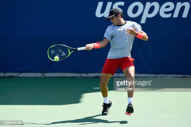 Jaume Munar of Spain returns the ball during his men's singles second round match against Diego Schwartzman of Argentina on Day Four of the 2018 US...