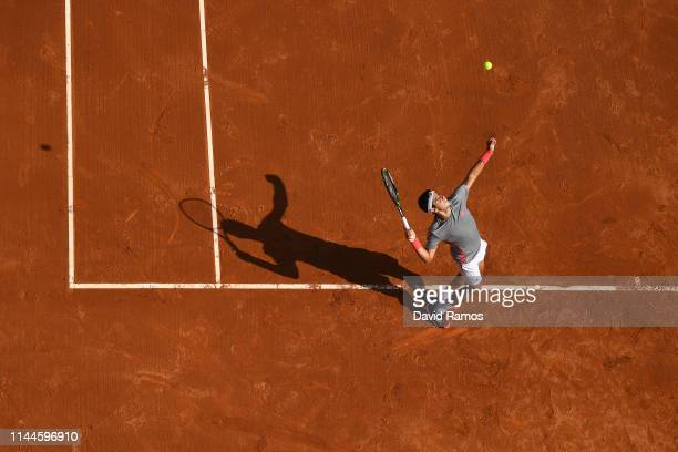 Jaume Munar of Spain serves against Frances Tiafoe of United States in their round of 32 match during day two of the Barcelona Open Banc Sabadell at...