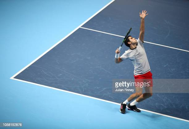 Jaume Munar of Spain serves in his group match against Stefanos Tsitsipas of Greece during Day One of the Next Gen ATP Finals at Fiera Milano Rho on...