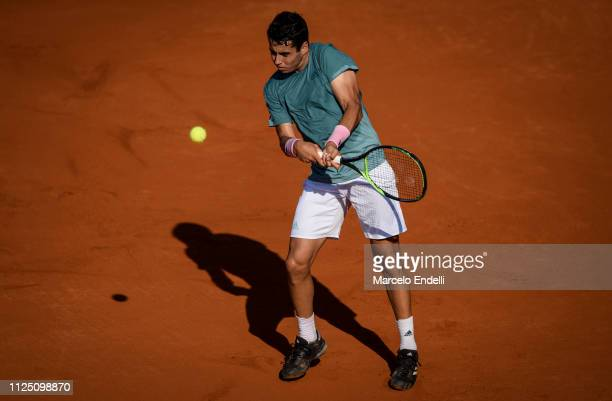 Jaume Munar of Spain takes a backhand shot against Guido Pella of Argentina during the Argentina Open ATP 250 2019 at Buenos Aires Lawn Tennis Club...