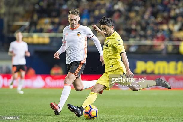 Jaume Vicent Costa Jordá of Villarreal CF competes for the ball with Alvaro Medran of Valencia CF during their La Liga match between Villarreal CF...