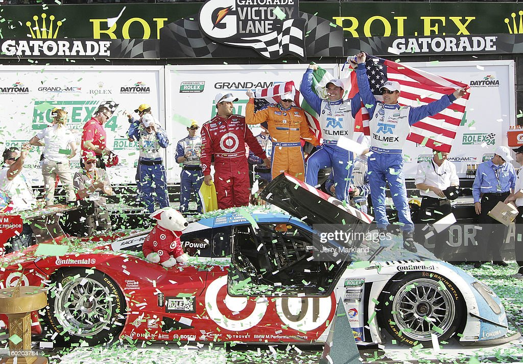 Jaun Pablo Montoya (l), Charlie Kimaball, Memo Rojas and Scott Pruett (r) drivers of the #01 Chip Ganassi Racing with Felix Sabetes TELMEX/Target BMW Riley celebrate in Victory Lane after winning the Rolex 24 at Daytona International Speedway on January 27, 2013 in Daytona Beach, Florida.