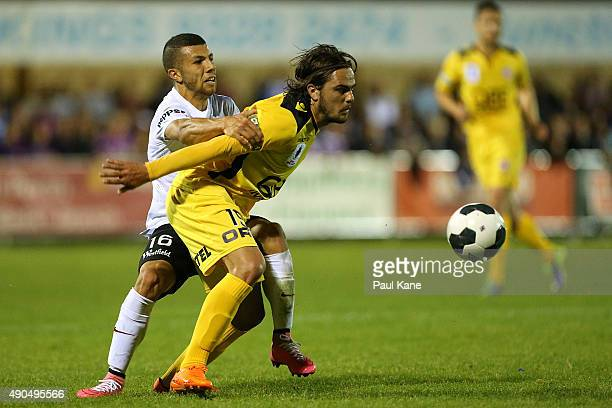 Jaushua Sotirio of the Wanderers and Josh Risdon of the Glory contest for the ball during the FFA Cup Quarter Final match between the Perth Glory and...
