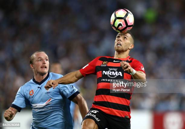 Jaushua Sotirio of the Wanderers competes for the ball against Rhyan Grant of Sydney FC during the round 20 ALeague match between the Western Sydney...