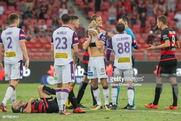 Jaushua Sotirio of the Wanderers lies on the pitch after being tackled by Glory's Liam Reddy during the round 23 ALeague match between the Western...