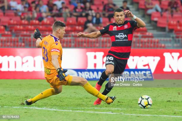 Jaushua Sotirio of the Wanderers taken out of play by Glory's goalkeeper Liam Reddy during the round 23 ALeague match between the Western Sydney...