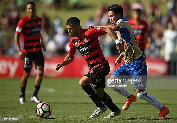 Jaushua Sotirio of the Wanderers takes on Ma Leilei of the Jets during the round 16 ALeague match between the Western Sydney Wanderers and the...
